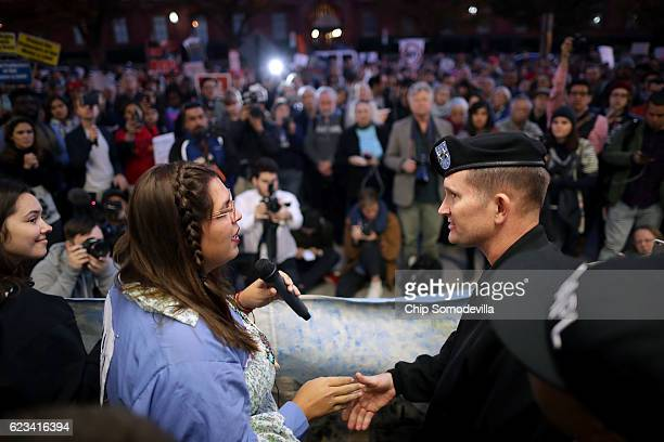 Erin Wise of Cannon Ball, North Dakota, shakes hands with Maj. Gen. Donald Jackson of the Army Corps of Engineers during a demonstration against the...