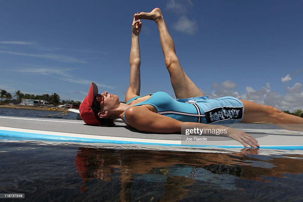 Erin Yanowitch enjoys a paddleboard yoga session at Adventure Sports Miami on July 10, 2011 in Miami, Florida. The paddle board is said to give the body's core more of a workout then in a gym since the platform is unstable and one must use the muscles to remain balanced on the board.