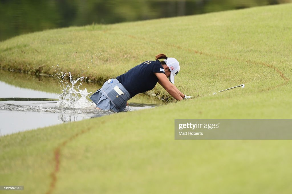 Erina Hara of Japan falls into the water on the 10th hole during the second round of the Resorttust Ladies at Kansai Golf Club on May 26, 2018 in Miki, Hyogo, Japan.