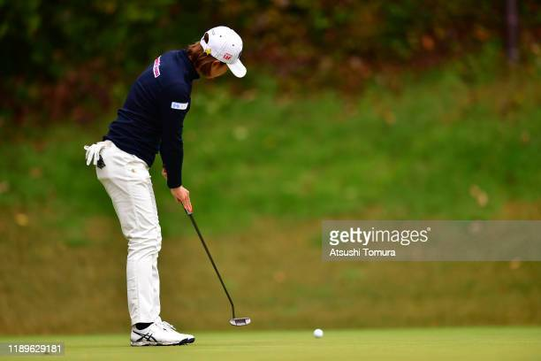 Erina Hara of Japan holes the birdie putt on the 10th green during the final round of the Daio Paper Elleair Ladies at Elleair Golf Club Matsuyama on...