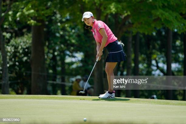 Erina Hara of Japan prepares to putt on the 15th green during the final round of the CyberAgent Ladies Golf Tournament at Grand fields Country Club...