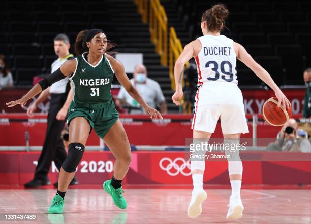 Erinma Ogwumike of Team Nigeria defends against Alix Duchet of Team France as she prepares to drive to the basket during the second half of a Women's...