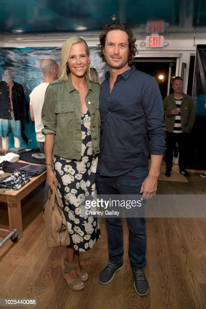 Erinn Bartlett and Oliver Hudson attend the launch of SEA JEANS celebrated by Outerknown at Ron Herman Melrose on August 30 2018 in Los Angeles...