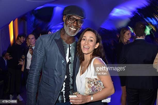 Eriq Ebouaney and Sanaa Alaoui attend the 'Hublot Blue' cocktail party At Monsieur Bleu Palais De Tokyo on June 24 2015 in Paris France