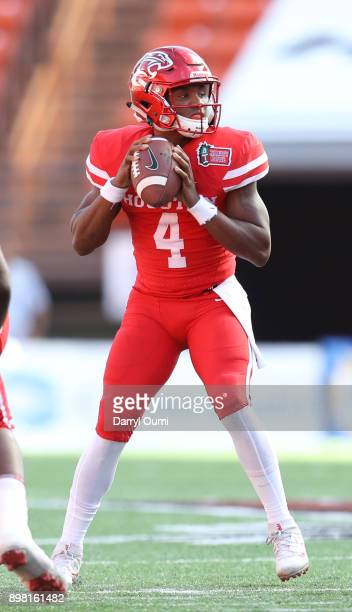 Eriq King of the Houston Cougars looks for an open receiver downfield during the first quarter of the Hawaii Bowl against the Fresno State Bulldogs...