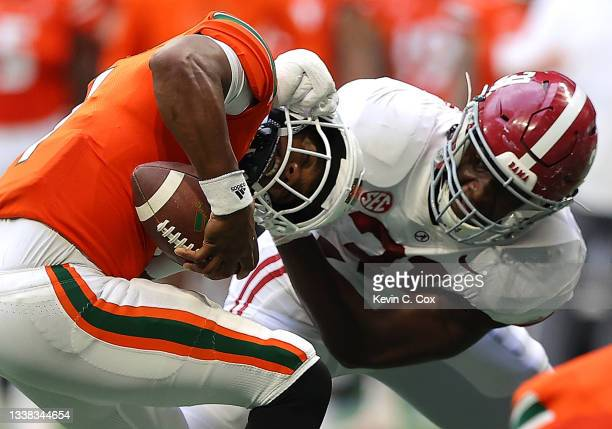 Eriq King of the Miami Hurricanes is escapes a sack attempt by Will Anderson Jr. #31 of the Alabama Crimson Tide during the second half of the...