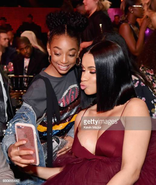 Eris Baker and Cardi B attend the 2018 iHeartRadio Music Awards which broadcasted live on TBS TNT and truTV at The Forum on March 11 2018 in...