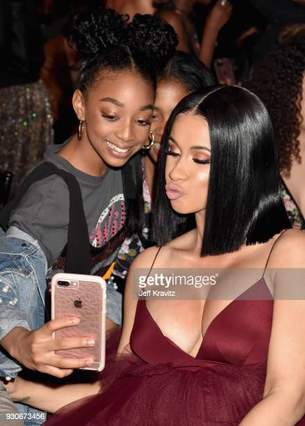 Eris Baker and Cardi B pose during the 2018 iHeartRadio Music Awards which broadcasted live on TBS TNT and truTV at The Forum on March 11 2018 in...