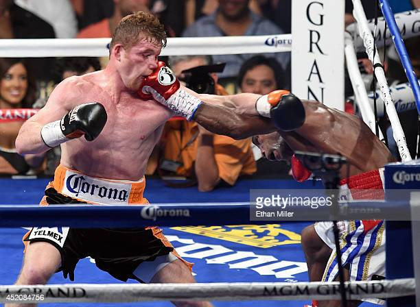 Erislandy Lara hits Canelo Alvarez in the fourth round of their junior middleweight bout at the MGM Grand Garden Arena on July 12 2014 in Las Vegas...