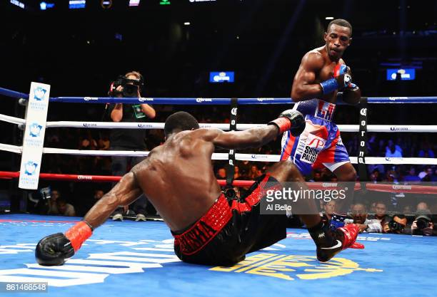 Erislandy Lara knocks down Terrell Gausha in the fourth round during their WBA Junior Middleweight Title bout at Barclays Center of Brooklyn on...