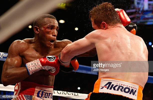 Erislandy Lara lands a left to the head of Canelo Alvarez during their junior middleweight bout at the MGM Grand Garden Arena on July 12 2014 in Las...