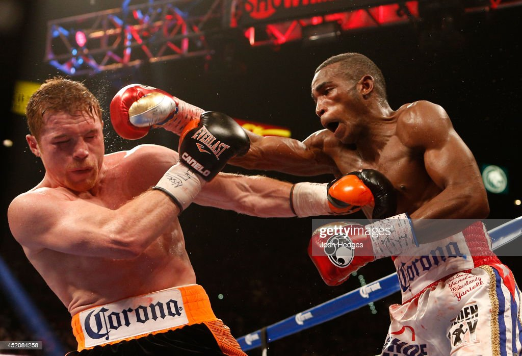 Erislandy Lara lands a right to the head of Canelo Alvarez during their junior middleweight bout at the MGM Grand Garden Arena on July 12, 2014 in Las Vegas, Nevada.