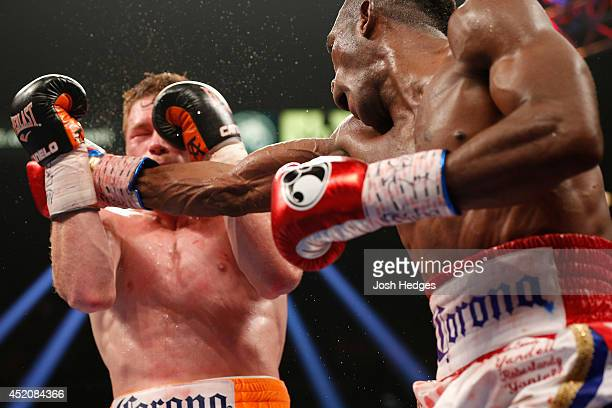 Erislandy Lara lands a right to the head of Canelo Alvarez during their junior middleweight bout at the MGM Grand Garden Arena on July 12 2014 in Las...