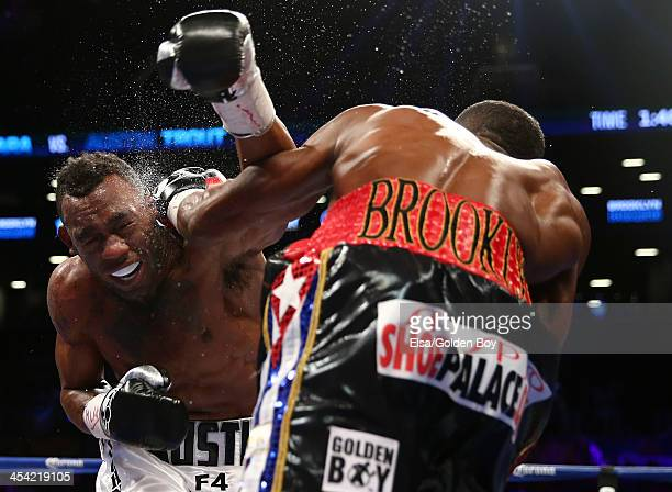 Erislandy Lara punches Austin Trout during their WBA Interim Super Welterweight title fight at Barclays Center on December 7 2013 in the Brooklyn...