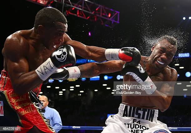 Erislandy Lara punches Austin Trout during their WBA Interim Super Welterweight title fight at Barclays Center on December 7, 2013 in the Brooklyn...