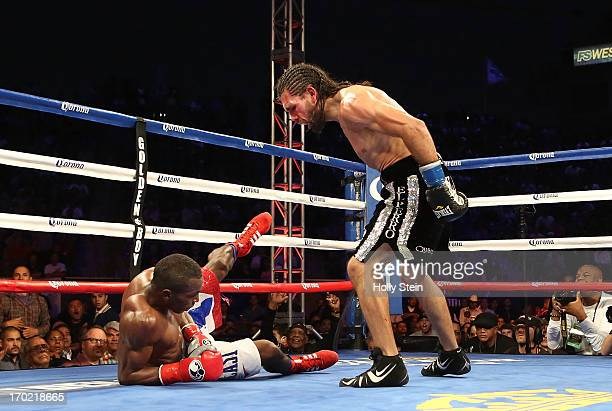 Erislandy Lara stands over Alfredo Angulo after knocking him down during their WBA Interim Super Welterweight title fight at the Home Depot Center on...