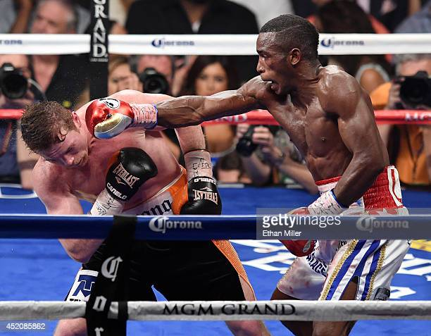 Erislandy Lara throws a right at Canelo Alvarez in the 11th round of their junior middleweight bout at the MGM Grand Garden Arena on July 12 2014 in...