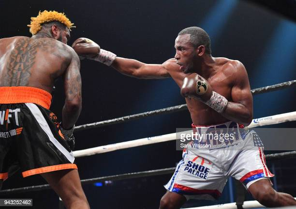 Erislandy Lara throws a right at Jarrett Hurd during their WBA/IBF junior middleweight unification title fight at The Joint inside the Hard Rock...