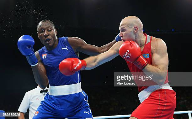 Erislandy Savon of Cuba and Vassiliy Levit of Kazakhstan trade punches in the Men's Super Heavyweight preliminaries on Day 8 of the 2016 Rio Olympics...
