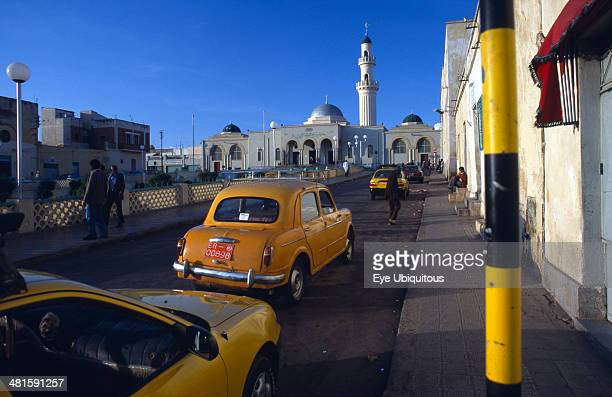 Eritrea Asmara Street scene with mosque and taxis