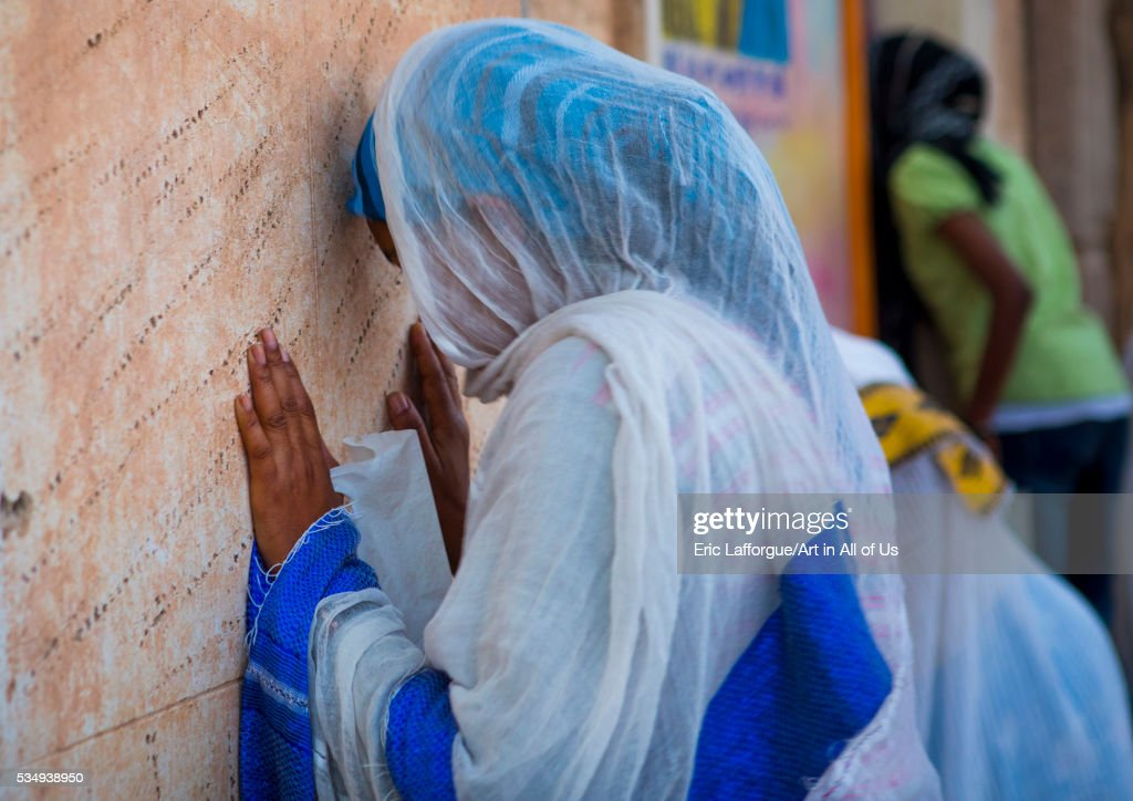 Eritrea, Horn Of Africa, Asmara, people praying in a church : News Photo