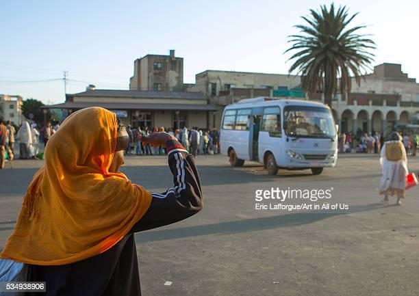 Eritrea, Horn Of Africa, Asmara, woman waiting for a bus