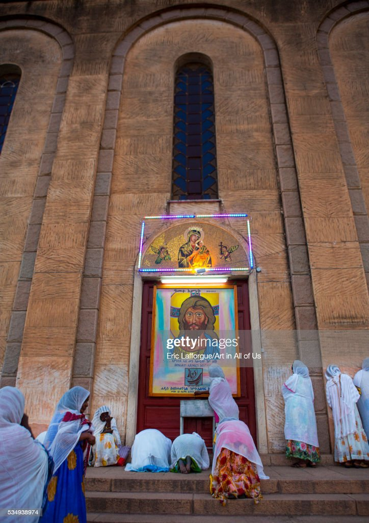 Eritrea, Horn Of Africa, Asmara, women praying on the stairs of a church : News Photo