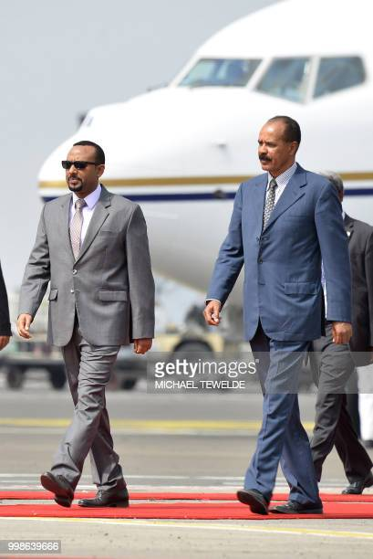 Eritrea president Issaias Afeworki is welcomed upon arrival by Prime minister of Ethiopia Abiy Ahmed on July 14 2018 at Addis Ababa Bole...