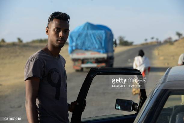 Eritrean Air Force serviceman Simon Kifle poses for a photograph on the Ethiopian side of the EthiopiaEritrea border on October 3 as he drives back...
