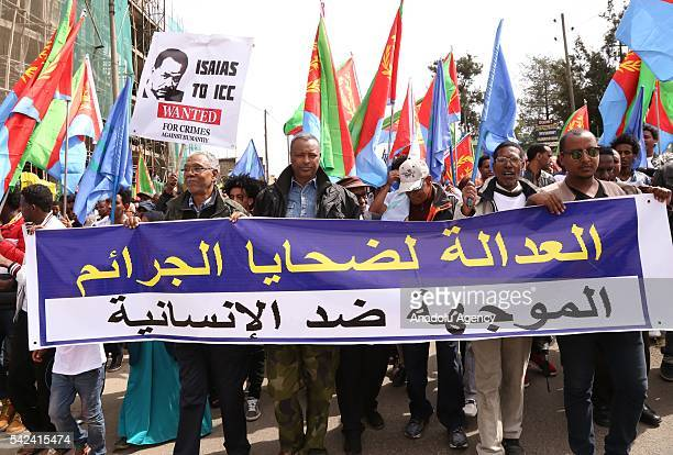 Eritrean asylum seekers gather outside the African Union Headquarters in Ethiopian capital Addis Ababa to protest against Eritrean President Isaias...