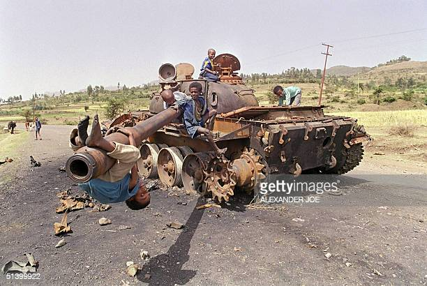 Eritrean children play 07 June 1991 on an Ethiopian army tank The roadside was destroyed by Eritrean Liberation Front rebels in the battle for Amara...