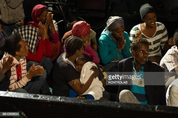 PORT CROTONE CALABRIA ITALY Eritrean families disembarked from the Italian Coast Guard ship They are around 90 between men women and children on...