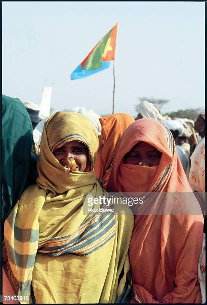 Eritrean nomads attend an EPLF recruitment drive at a desert wadi in northern Eritrea 20th June 1978 There is an Eritrean flag in the background