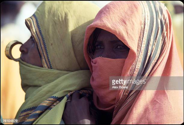 Eritrean nomads attend an EPLF recruitment drive at a desert wadi in northern Eritrea 20th June 1978 They are both wearing the traditional abaya