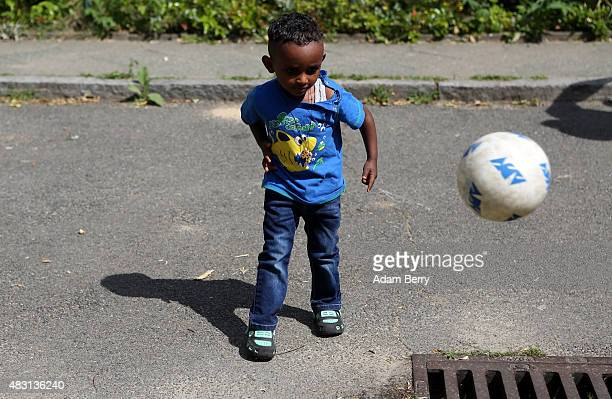 Eritrean refugee boy Esey plays with a soccer ball after his mother's German language class at a temporary home providing assistance for refugees on...