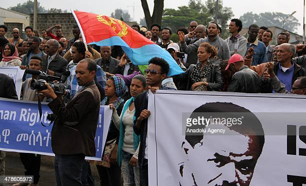 Eritrean refugees stage a demonstration in front of the African Union headquarters against Eritrean President Isaias Afewerki on June 26 2015 in...