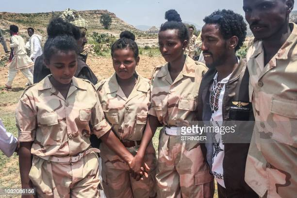 Eritrean soldiers react on September 11 2018 in Serha Eritrea as two land border crossings between Ethiopia and Eritrea were reopened for the first...