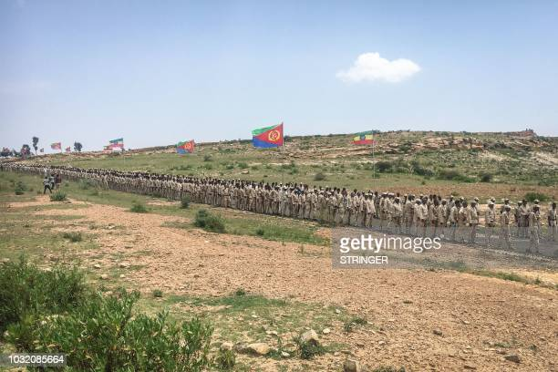 Eritrean soldiers wait in a line on September 11 2018 to cross the border to attend the border reopening ceremony with Ethiopians as two land border...