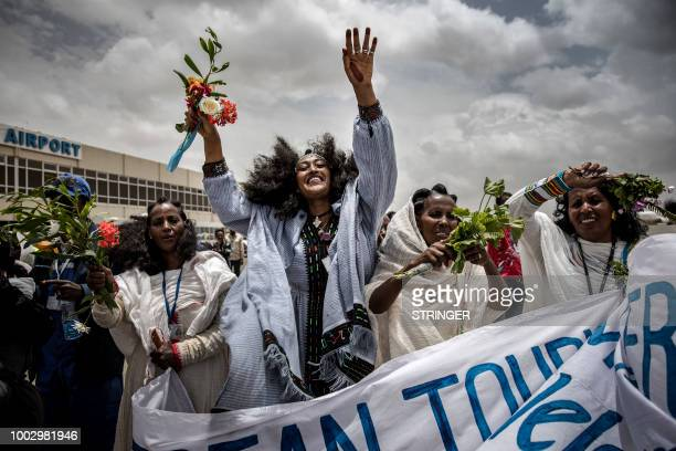 TOPSHOT Eritrean women celebrate on the tarmac to welcome passengers of the flight from Ethiopian capital Addis Ababa upon the arrival at Asmara...