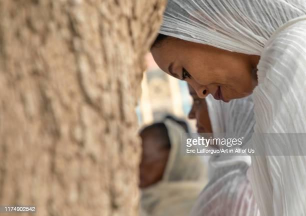 Eritrean women praying in enda mariam orthodox cathedral, Central region, Asmara, Eritrea on August 18, 2019 in Asmara, Eritrea.