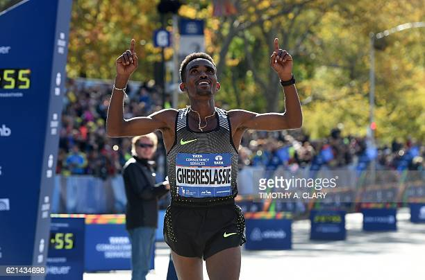 Eritrea's Ghirmay Ghebresiassie crosses the finish line to win the Men's Division during the the 2016 TCS New York City Marathon November 6 2016 in...
