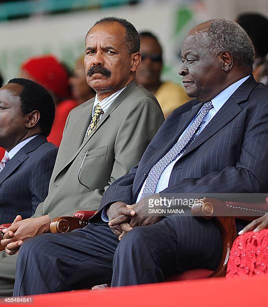 Eritrea's president Isaias Afewerki sits next to Kenya former president Mwai Kibaki at the Kasarani stadium in Nairobi on December 12 2013 during...