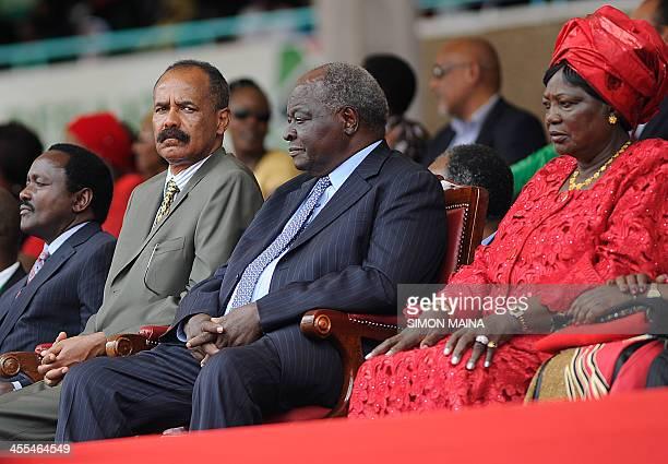 Eritrea's president Isaias Afewerki sits next to Kenya former president Mwai Kibaki and Ngina Kenyatta at the Kasarani stadium in Nairobi on December...