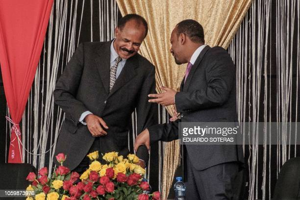 Eritrea's President Isaias Afwerki and Ethiopia's Prime Minister Abiy Ahmed talk during the inauguration of the Tibebe Ghion Specialized Hospital in...
