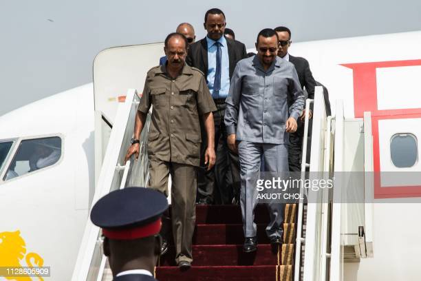 Eritrea's President Isaias Afwerki and Ethiopia's Prime Minister Abiy Ahmed disembark from an airplane upon arrival at Juba International Airport in...