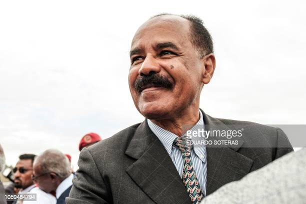 Eritrea's President Isaias Afwerki smiles upon his arrival at the airport in Gondar, for a visit in Ethiopia, on November 9, 2018.