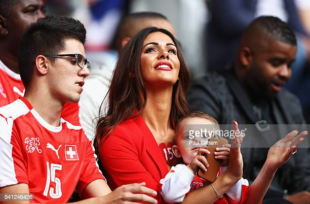 Erjona Sulejmani wife of Blerim Dzemaili of Switzerland is seen prior to the UEFA EURO 2016 Group A match between Switzerland and France at Stade...