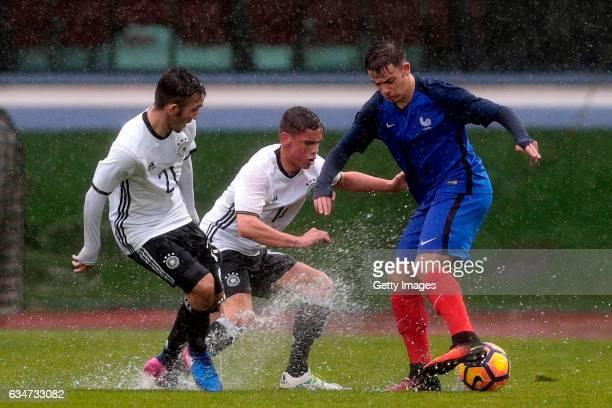 Erkan Eyibil and Oliver BatistaMeier of Germany U16 challenge Bilel Hassaini of France U16 during the UEFA Development Tournament Match between...