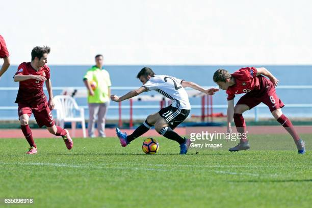 Erkan Eyibil of Germany U16 challenges Daniel Martins and Rafael Pereira of Portugal U16 during the UEFA Development Tournament Match between Germany...
