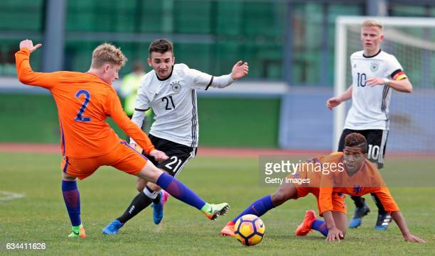 Erkan Eyibil of Germany U16 challenges Vincent Schippers and Shurandy Sambo of Netherlands U16 during the UEFA Development Tournament Match between...